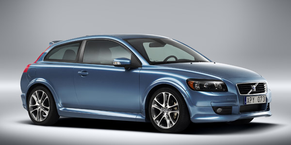 Volvo C30 (blue) with bodykit, front view.