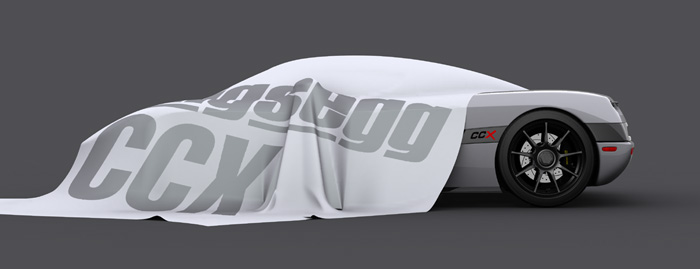 The Koenigsegg CCX, half covered by cloth.
