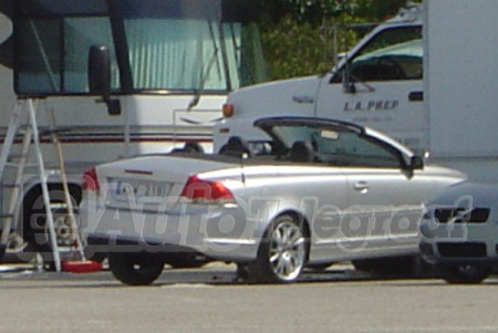 New Volvo C70 in Silver metallic, seen from behind with top down.
