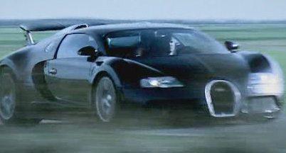 Blonde guy driving a Bugatti Veyron, possibly Top Gear's the Stig