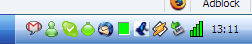 Screenshot of Windows System Tray with IM/chat applications. Google Talk, Windows Live (MSN) Messenger, Wengo/Wengophone.